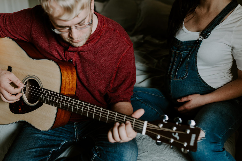 dad-playing-guitar-to-belly-on-bed-maternity-desmoines-iowa-raelyn-ramey-photography-21.jpg