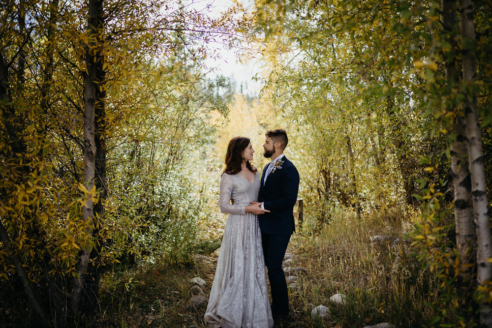 bride-and-groom-standing-in-woods-double-a-barn-grand-lake-colorado-raelyn-ramey-photography-503.jpg