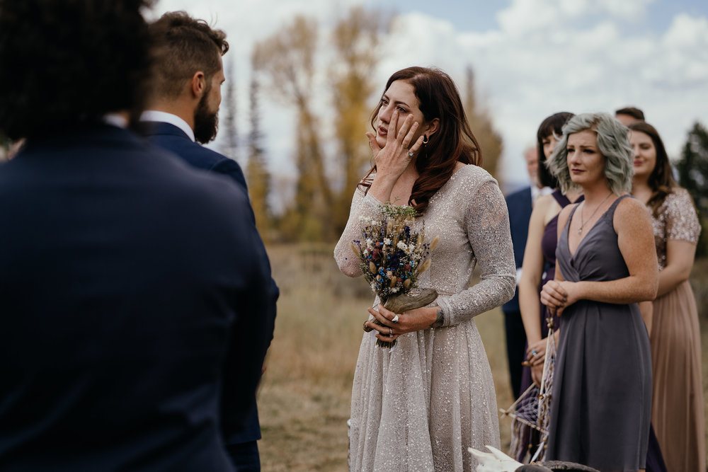 bride-crying-during-ceremony-double-a-barn-grand-lake-colorado-raelyn-ramey-photography-429.jpg