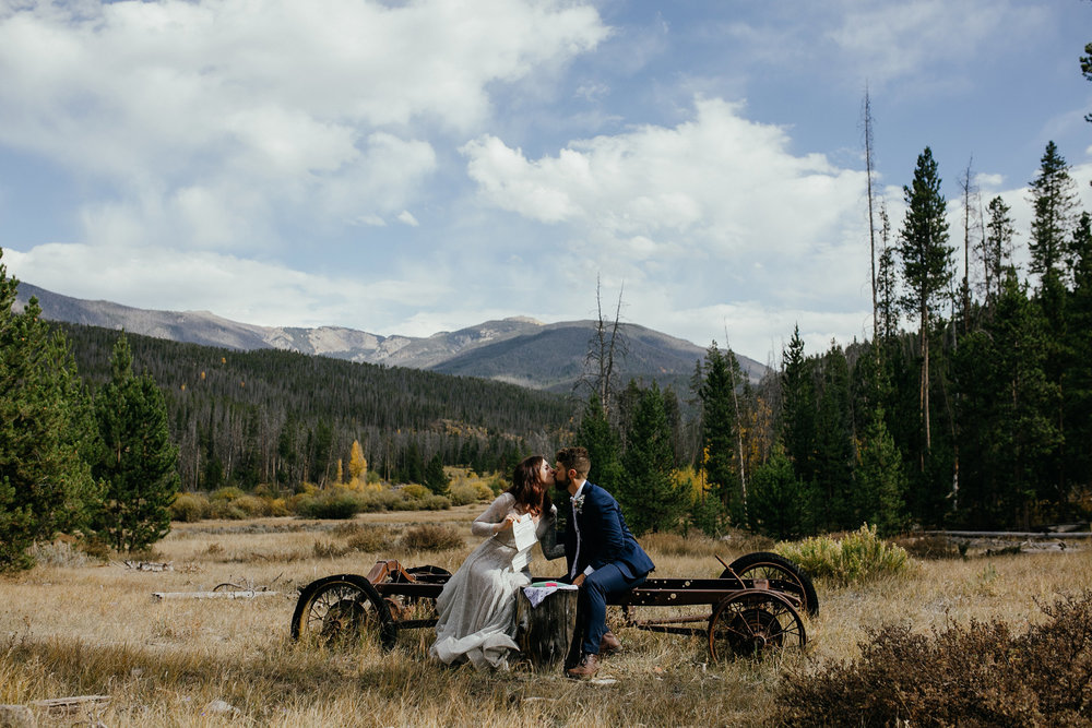 bride-groom-kissing-after-signing-marriage-certificate-double-a-barn-grand-lake-colorado-raelyn-ramey-photography-481.jpg