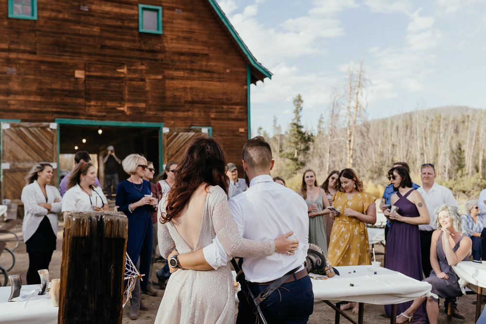bride-groom-listening-to-speeches-double-a-barn-grand-lake-colorado-raelyn-ramey-photography-634.jpg