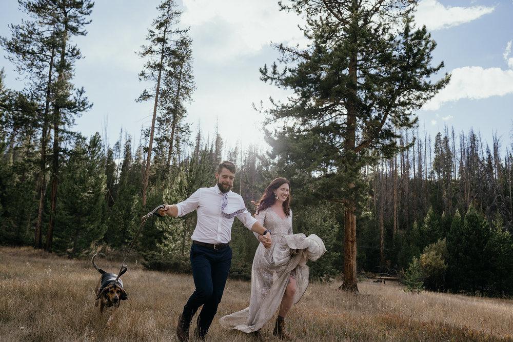 bride-groom-running-with-dog-double-a-barn-grand-lake-colorado-raelyn-ramey-photography-589.jpg