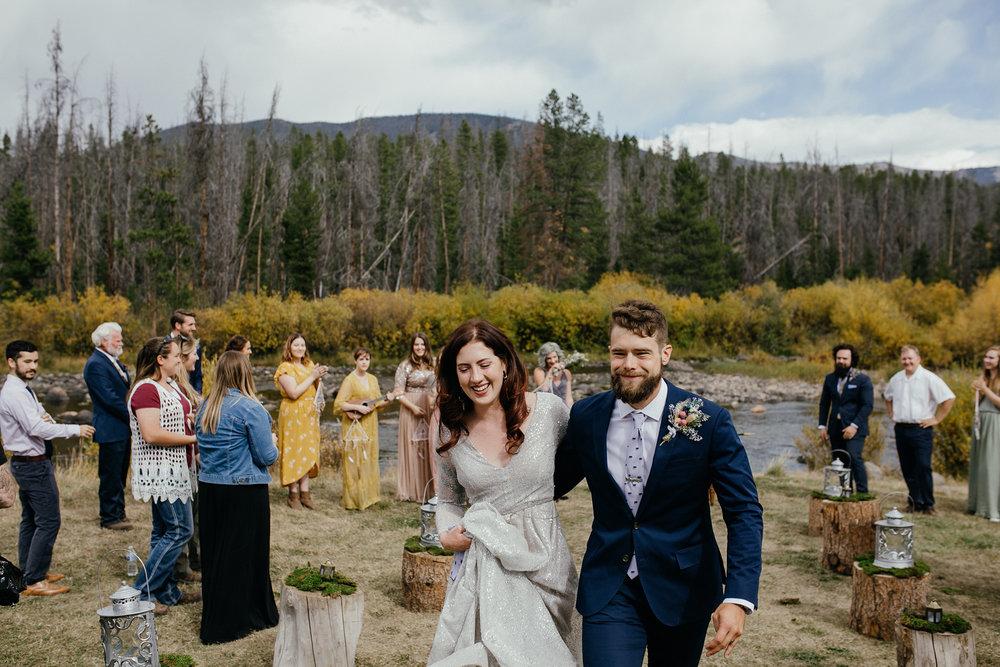 bride-groom-walking-after-ceremony-double-a-barn-grand-lake-colorado-raelyn-ramey-photography-457.jpg