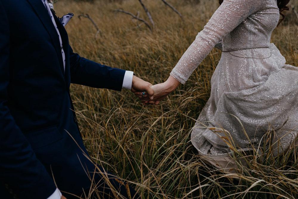 bride-groom-walking-holding-hands-double-a-barn-grand-lake-colorado-raelyn-ramey-photography-370.jpg