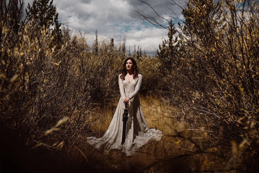bride-holding-sword-wedding-double-a-barn-grand-lake-colorado-raelyn-ramey-photography-194.jpg