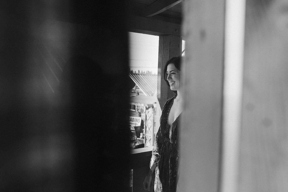 bride-through-a-window-lupine-village-grand-lake-colorado-raelyn-ramey-photography-27.jpg