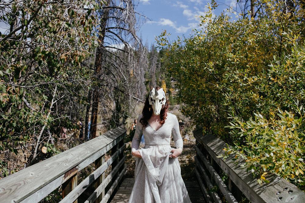 bride-wearing-skull-unicorn-mask-double-a-barn-grand-lake-colorado-raelyn-ramey-photography-219.jpg