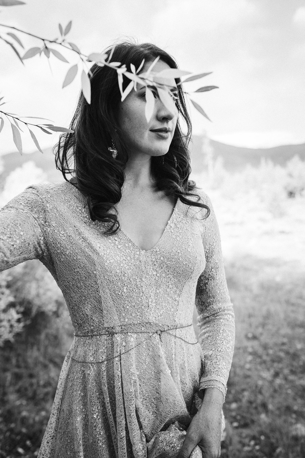 bride-with-leaves-in-front-of-eyes-double-a-barn-grand-lake-colorado-raelyn-ramey-photography-517.jpg