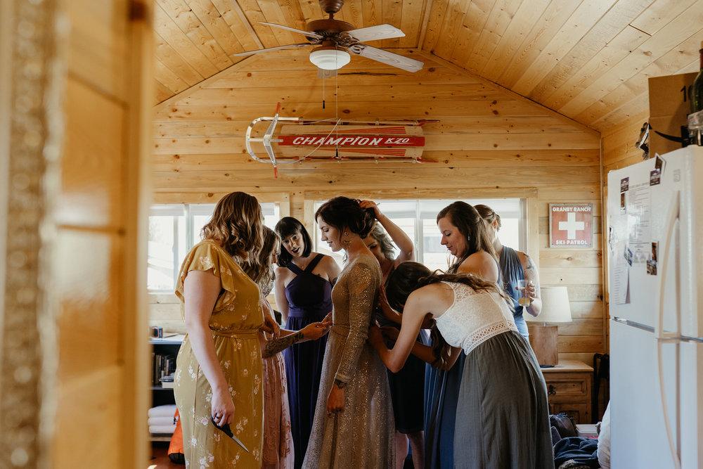 bridesmaids-helping-bride-get-ready-lupine-village-double-a-barn-grand-lake-colorado-raelyn-ramey-photography-50.jpg