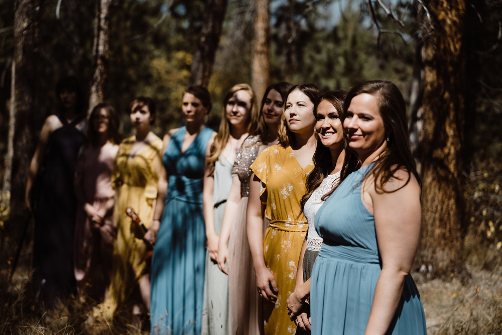 bridesmaids-standing-in-sunlight-in-trees-double-a-barn-grand-lake-colorado-raelyn-ramey-photography-208.jpg