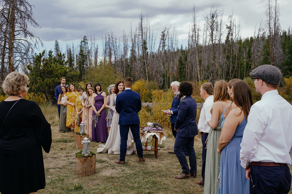 ceremony-next-to-creek-in-mountains-double-a-barn-grand-lake-colorado-raelyn-ramey-photography-425.jpg