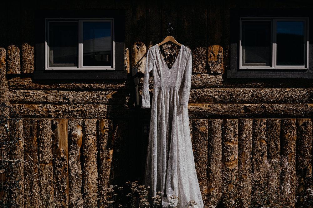 dress-hanging-on-cabin-lupine-village-grand-lake-colorado-raelyn-ramey-photography-8.jpg
