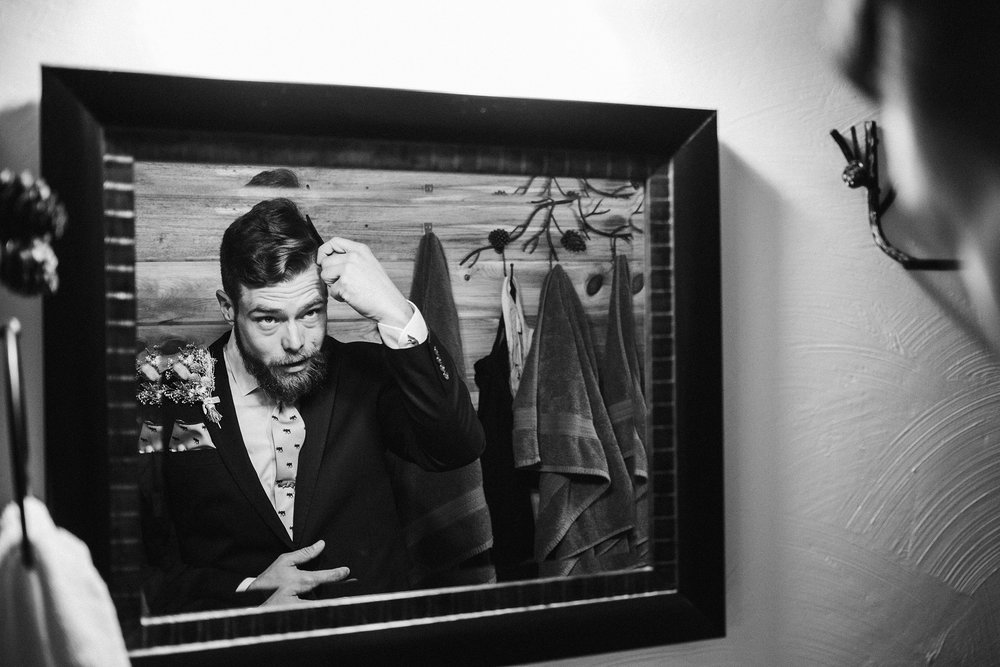 groom-combing-hair-double-a-barn-grand-lake-colorado-raelyn-ramey-photography-122.jpg