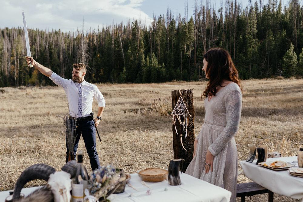groom-holding-sword-in-the-air-double-a-barn-grand-lake-colorado-raelyn-ramey-photography-608.jpg