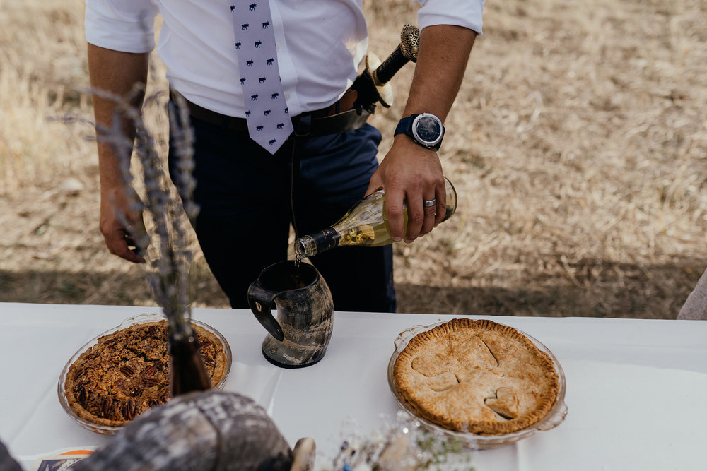 groom-pouring-mead-for-toast-double-a-barn-grand-lake-colorado-raelyn-ramey-photography-603.jpg