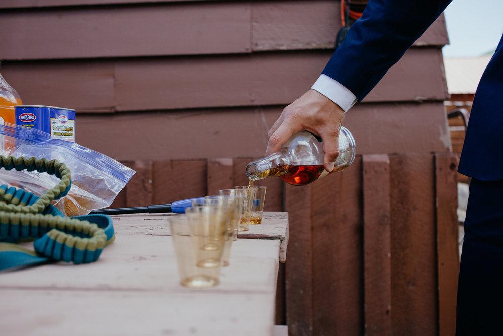 groomsmen-pouring-shots-double-a-barn-grand-lake-colorado-raelyn-ramey-photography-132.jpg