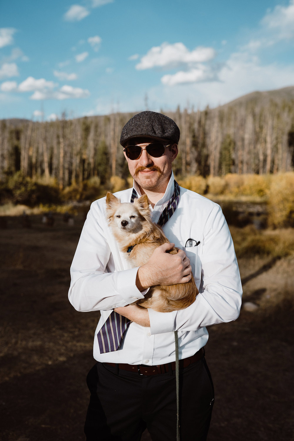 guest-holding-small-pup-double-a-barn-grand-lake-colorado-raelyn-ramey-photography-717.jpg