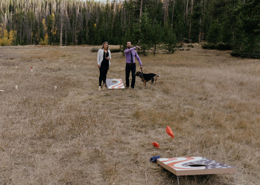 guests-playing-corn-hole-game-double-a-barn-grand-lake-colorado-raelyn-ramey-photography-720.jpg