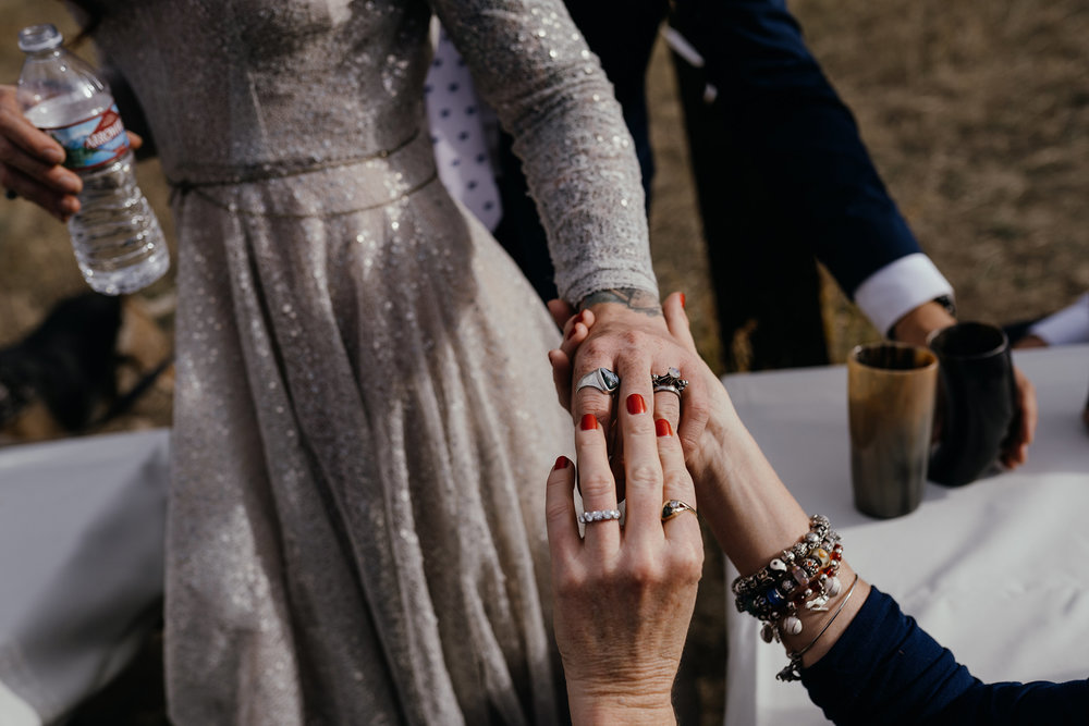 mother-of-bride-looking-at-wedding-ring-with-bats-double-a-barn-grand-lake-colorado-raelyn-ramey-photography-574.jpg