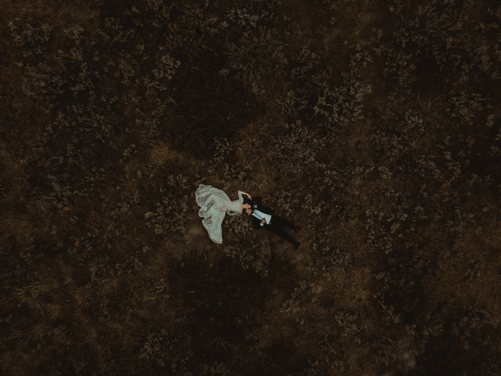 mr-mrs-likes-double-a-barn-drone-shot-of-couple-laying-in-sage-grand-lake-colorado-raelyn-ramey-photography-366.jpg
