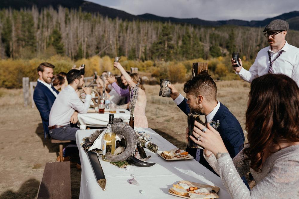 toast-to-bride-and-groom-double-a-barn-grand-lake-colorado-raelyn-ramey-photography-569.jpg