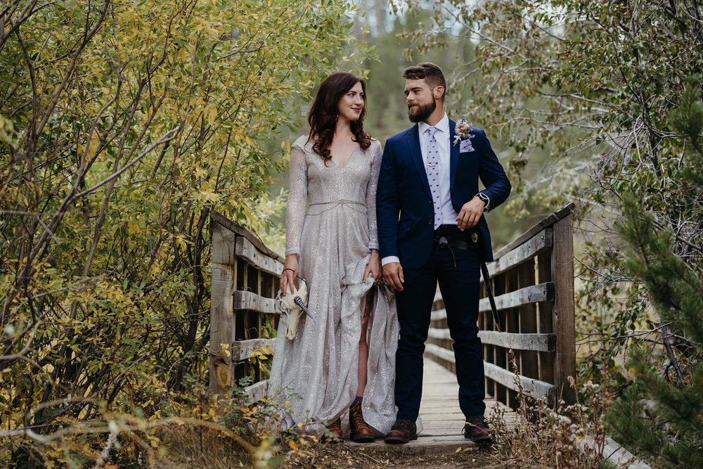 wedding-couple-holding-a-unicorn-mask-and-sword-double-a-barn-grand-lake-colorado-raelyn-ramey-photography-238.jpg