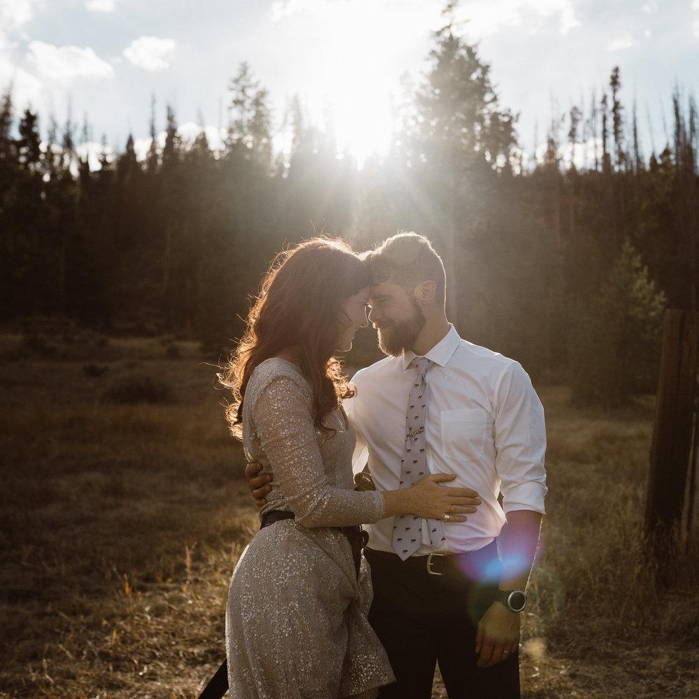 wedding-couple-holding-each-other-in-sun-light-grand-lake-colorado-raelyn-ramey-photography-654.jpg