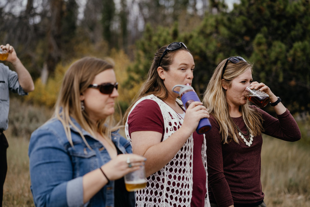 wedding-guests-drinking-during-ceremony-double-a-barn-grand-lake-colorado-raelyn-ramey-photography-455.jpg