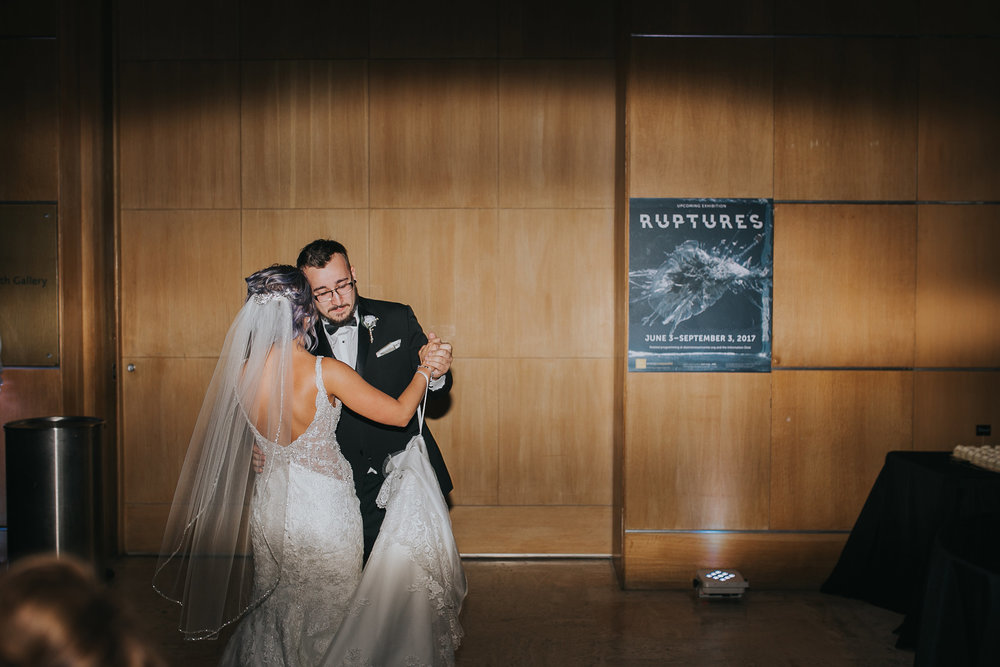 bride-dancing-with-brother-slow-desmoines-iowa-art-center-raelyn-ramey-photography.jpg
