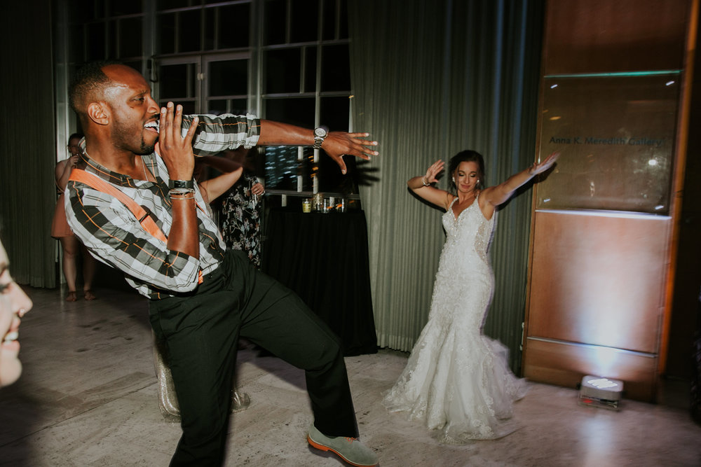 bride-dancing-with-guest-desmoines-iowa-art-center-raelyn-ramey-photographyjpg