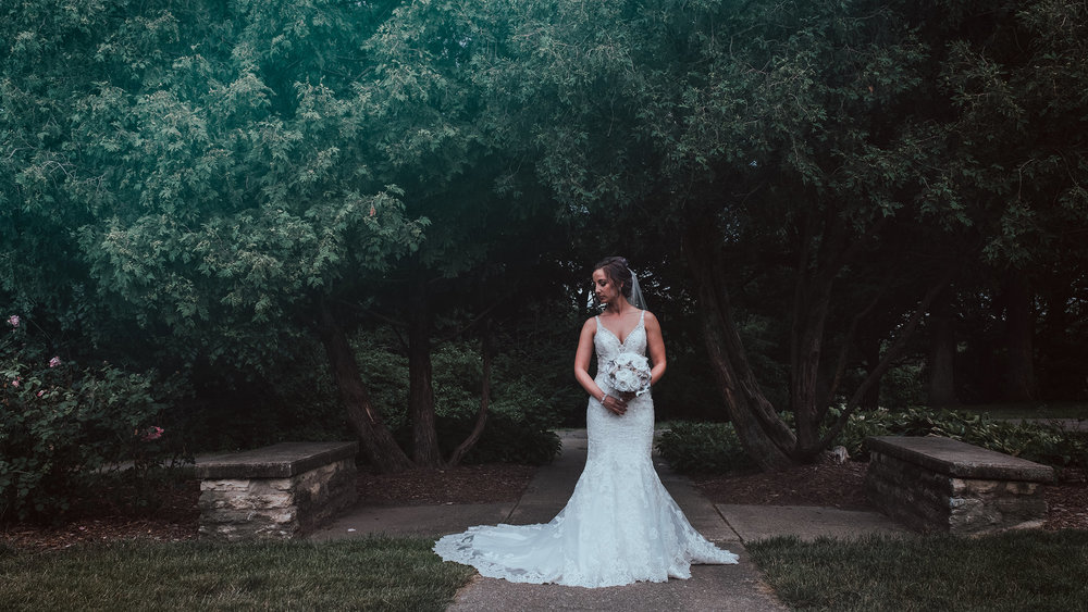 bride-portrait-in-front-of-trees-desmoines-iowa-art-center-raelyn-ramey-photography.jpg