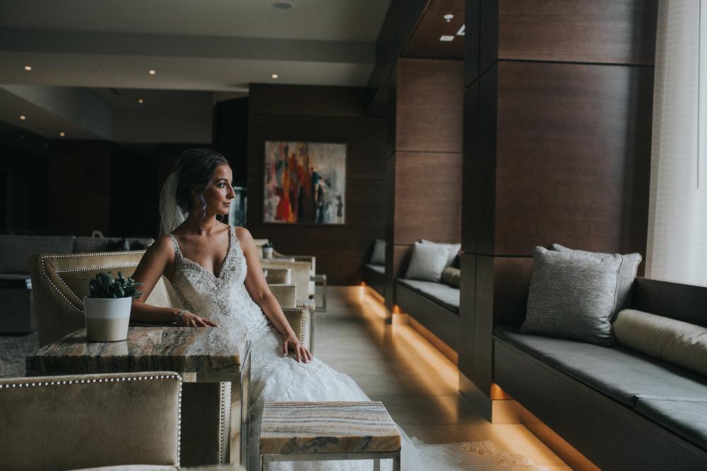 bride-sitting-in-lobby-desmoines-iowa-ac-hotel-raelyn-ramey-photography.jpg