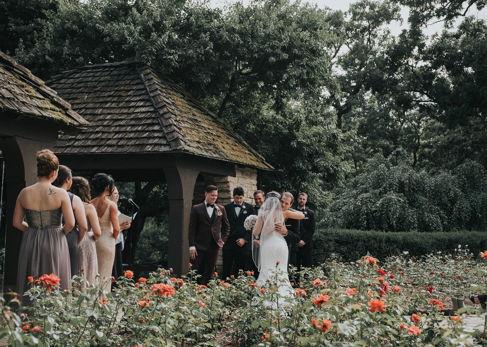 brides-dad-giving-her-away-during-ceremony-desmoines-iowa-rose-garden-raelyn-ramey-photography.jpg