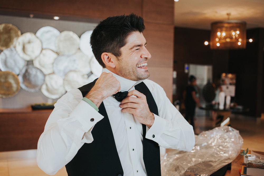 groomsmen-getting-ready-in-lobby-desmoines-iowa-ac-hotel-raelyn-ramey-photography.jpg