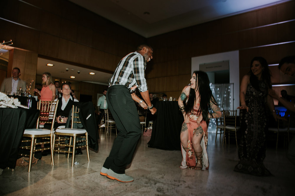 guest-laughing-and-dancing-on-the-dance-floor-after-hours-desmoines-iowa-art-center-raelyn-ramey-photography.jpg