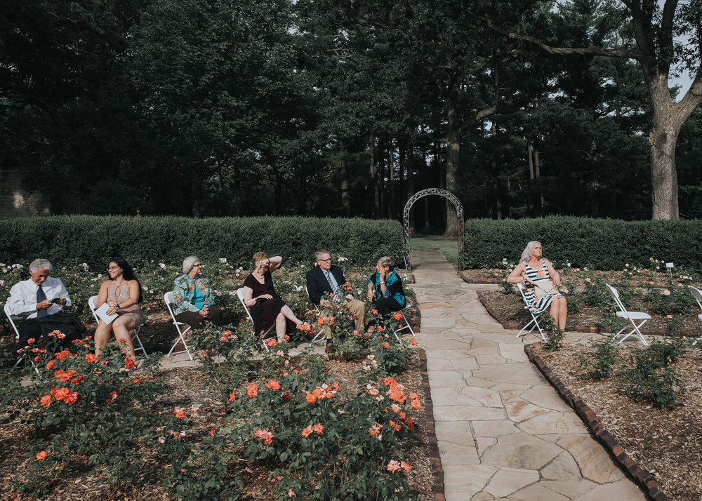 guests-waiting-for-ceremony-to-start-desmoines-iowa-rose-garden-raelyn-ramey-photography.jpg