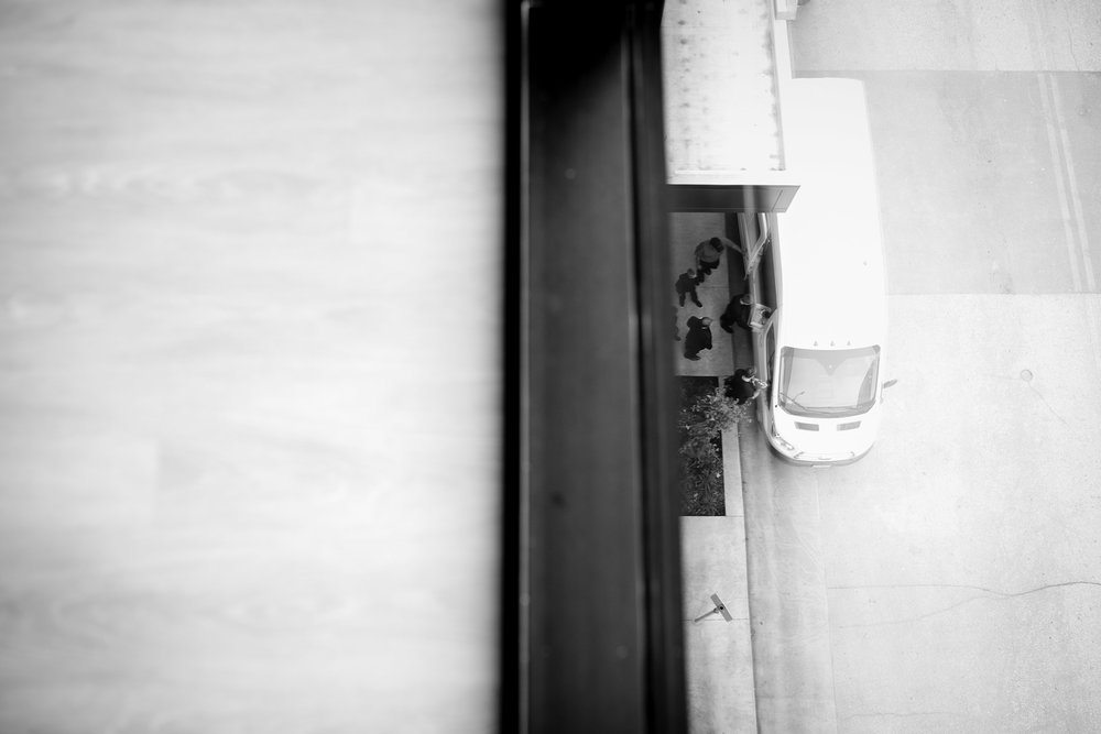 looking-down-from-suite-to-guys-getting-in-cars-raelyn-ramey-photography.jpg
