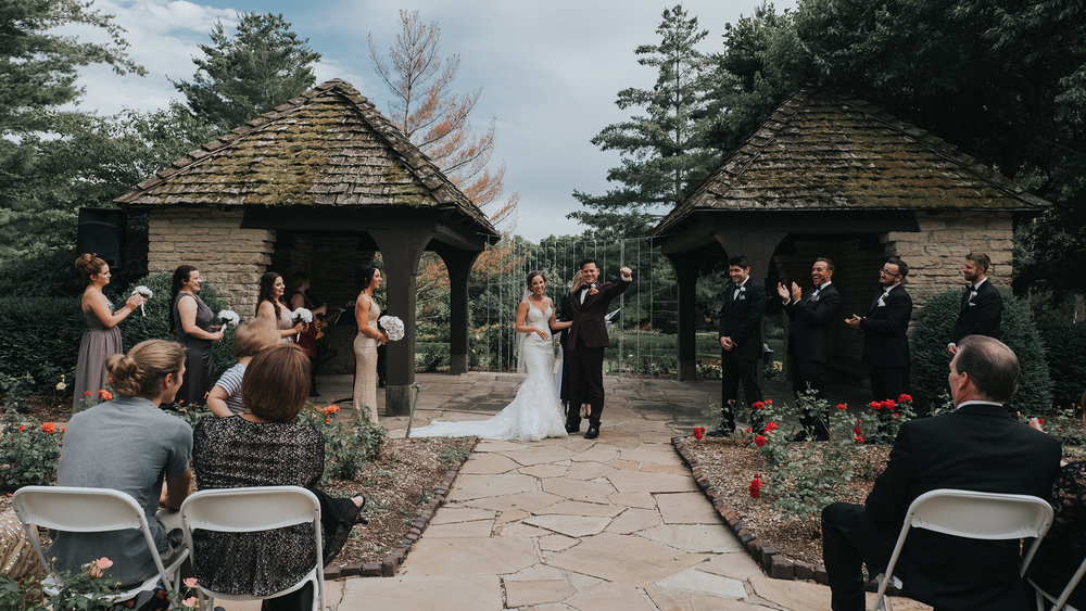 wedding-couple-excited-after-first-kiss-desmoines-iowa-rose-garden-raelyn-ramey-photography.jpg