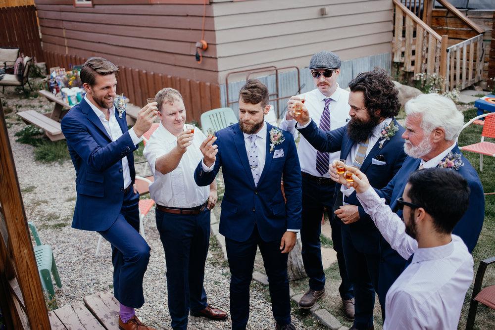 groomsmen-taking-shots-lupine-village-double-a-barn-grand-lake-colorado-raelyn-ramey-photography-134.jpg