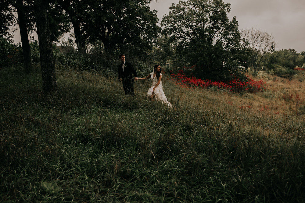 bride-groom-walking-up-hill-at-park-omaha-nebraska-raelyn-ramey-photography.jpg