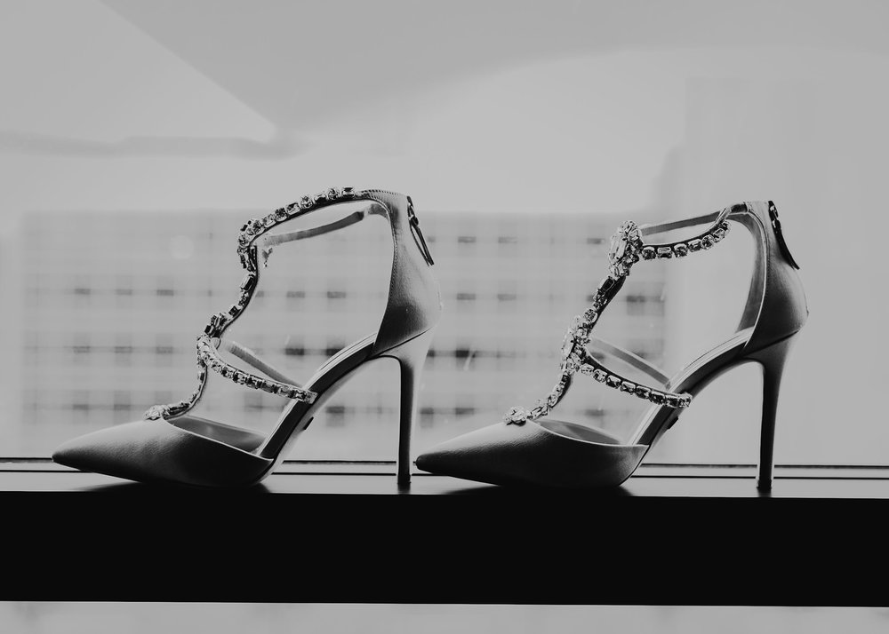 bride-shoes-in-window-hilton-omaha-nebraska-raelyn-ramey-photography.jpg