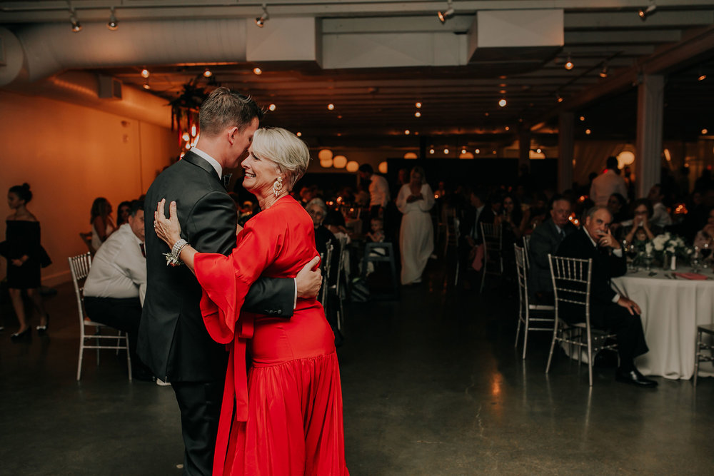 first-dancing-groom-and-mother-while-smiling-founders-one-nine-omaha-nebraska-raelyn-ramey-photography.jpg