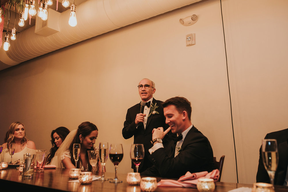 groom-and-bride-listening-to-dad-speech-omaha-nebraska-raelyn-ramey-photography.jpg