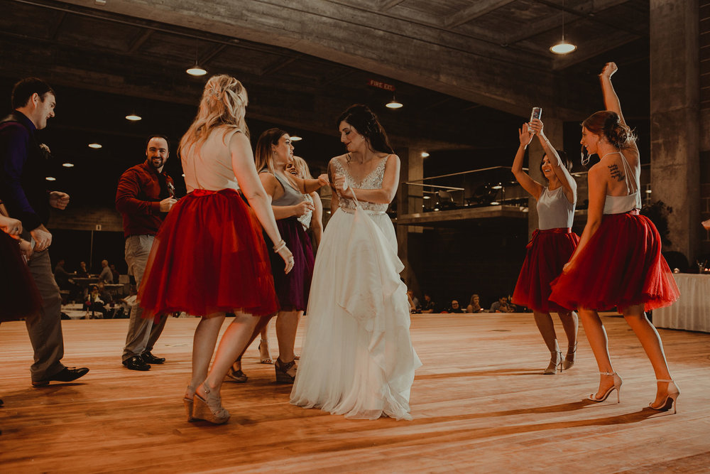 bride-and-bridesmaids-dancing-at-reception-pella-plaza-desmoines-iowa-raelyn-ramey-photography.jpg