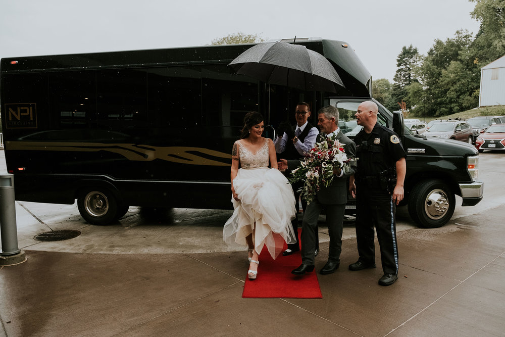 bride-getting-off-bus-pella-plaza-desmoines-iowa-raelyn-ramey-photography.jpg