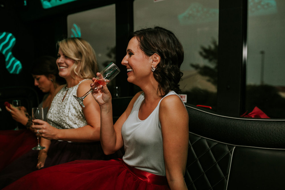 bridesmaid-drinking-and-laughing-pella-plaza-desmoines-iowa-raelyn-ramey-photography.jpg