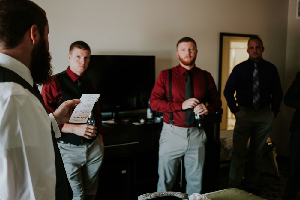 groom-reading-vows-to-groomsmen-prairie-meadows-desmoines-iowa-raelyn-ramey-photography.jpg