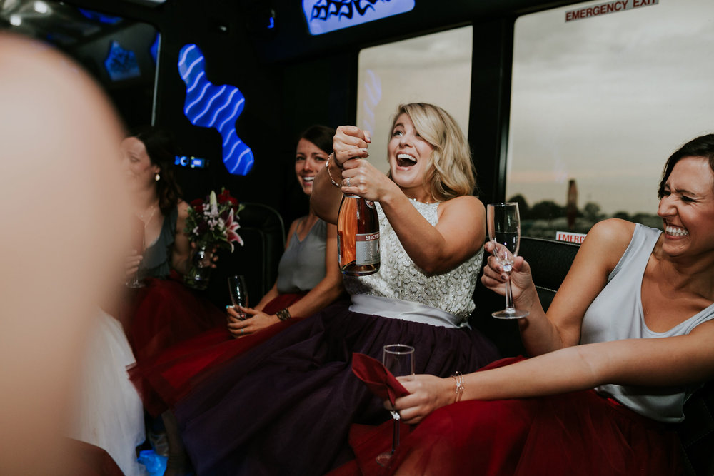 maid-of-honor-popping-champagn-pella-plaza-desmoines-iowa-raelyn-ramey-photography.jpg