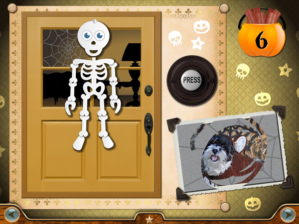 Knock on the door or press the doorbell to see whether you earned a trick or a treat. You can also scratch off the card to see photos of Millie in fancy Halloween costumes.