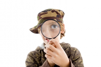 ('boy holding magnifying glass' photo by imargery majestic')